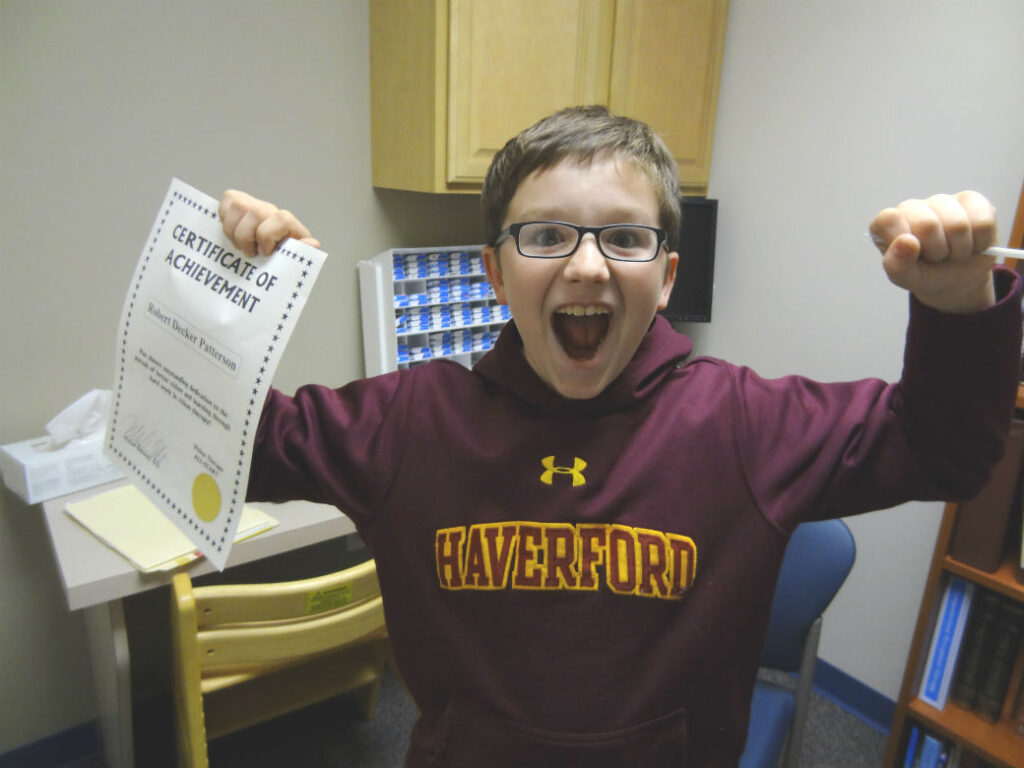 photo of Decker with certificate