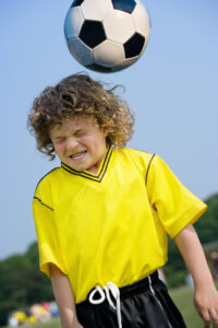Boy heading soccer ball vision therapy after concussion